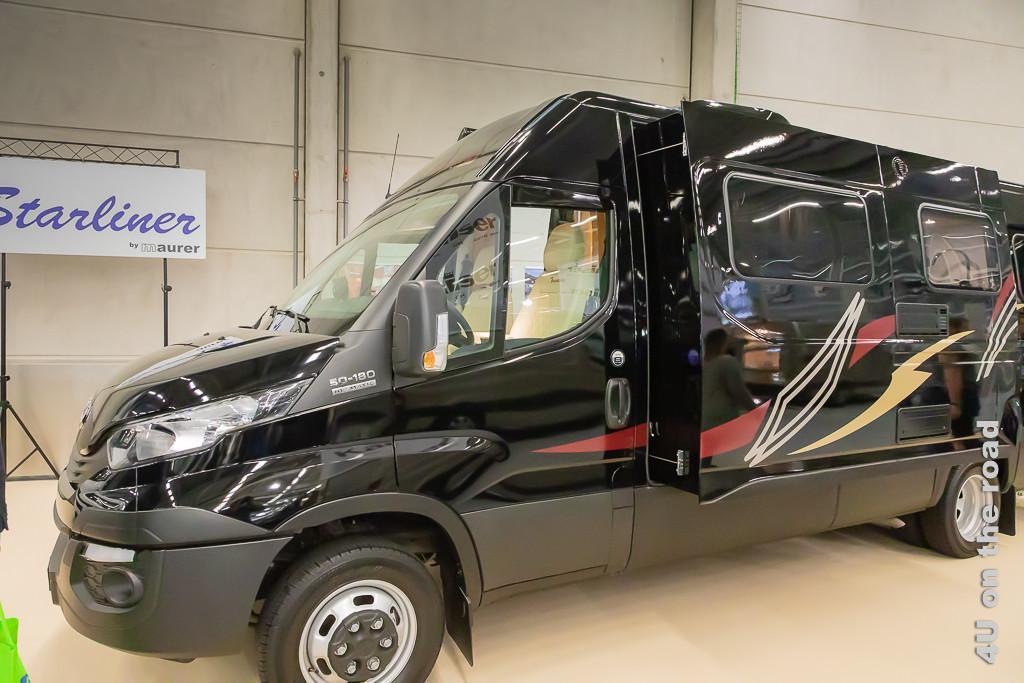 Im Bild die Slide-out-Variante eines Lieferwagens zum halb autarken Wohnmobil umgebaut
