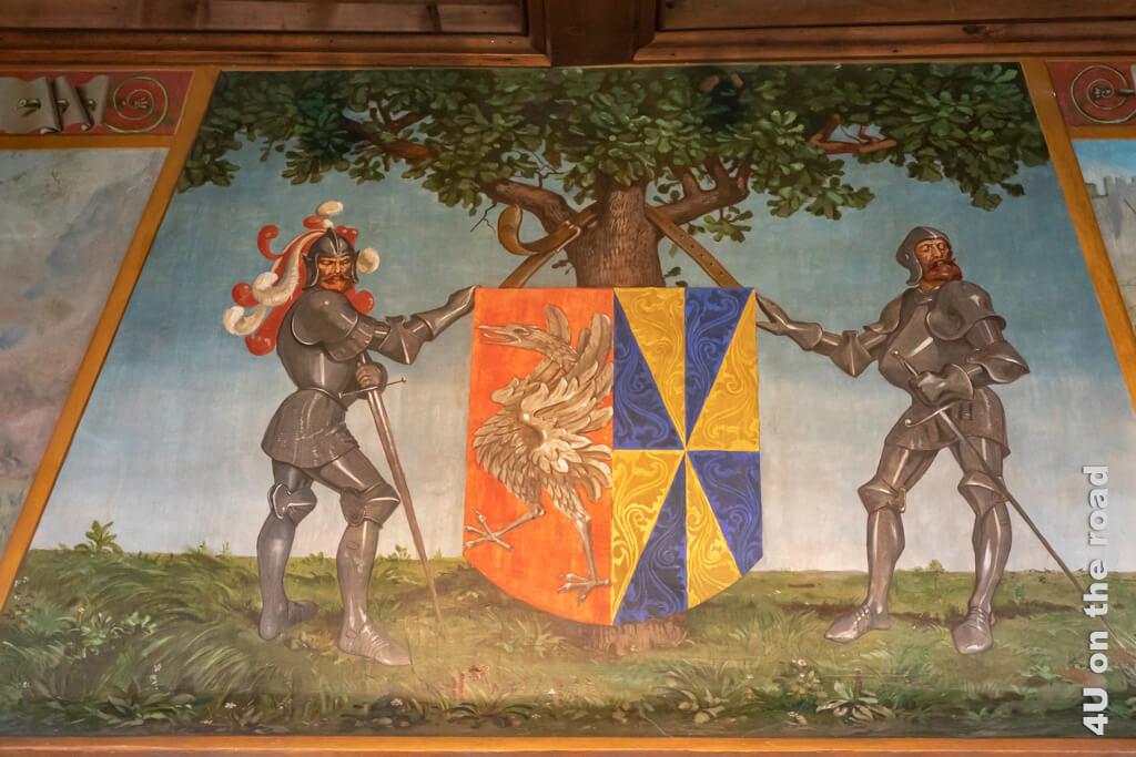 Die Spitzbauch-Mode bei Ritterrüstungen auf einem Bild im Rittersaal des Schloss Gruyères