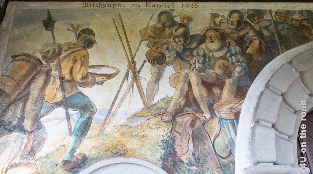 Illustration der Kappeler Milchsuppe von der Deubüelerkapelle. Die Zürcher halten das Brot in den Händen, die Innerschweizer kommen mit der Milch.