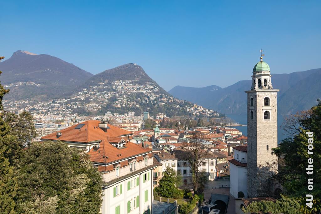 Der Blick auf Lugano und die Kathedrale San Lorenzo. Der Parco Ciani ist nur an den alten Bäumen zu erkennen.